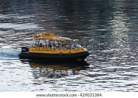 Sydney, Australia - 2016, Mar 26: Yellow water taxi on duty. People travelling on water taxi over Darling Harbour
