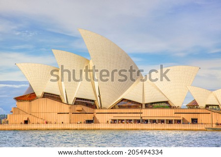 SYDNEY, AUSTRALIA - MAY 20, 2010: A close-up side view of Sydney Opera House. With its interlocking roof or 'shells' it is Australia's most recognisable building and a UNESCO World Heritage Site. - stock photo