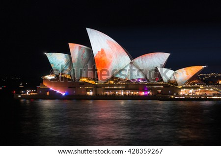 Sydney, Australia - 2016, May 27: Annual outdoor lighting festival Vivid Sydney: Festival of Light, Music & Ideas. Sydney Opera House illumination Lighting the Sails Songlines. Long Exposure