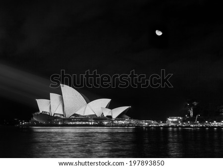 SYDNEY, AUSTRALIA - MAY 19, 2014: Beautiful view of the Sydney Opera House is being illuminated during night time. - stock photo