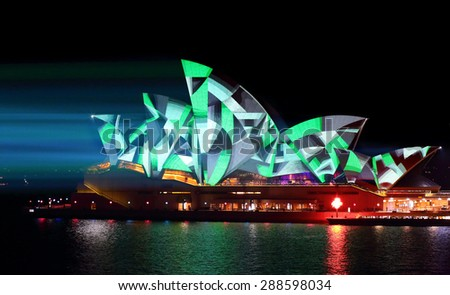 SYDNEY, AUSTRALIA - MAY 25, 2015;   Light beams stream onto the iconic landmark, the Sydney Opera House casting various moving patterns, like this geometric pattern during Vivid Sydney - stock photo