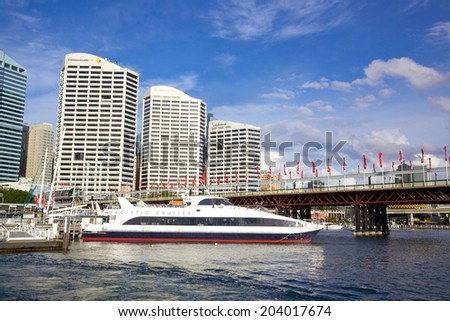 SYDNEY, AUSTRALIA - MAY 20, 2010: Office blocks overlooki Darling Harbour, a harbour and recreational and pedestrian precinct adjacent to the city centre of Sydney in New South Wales.