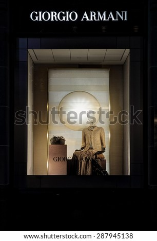 SYDNEY, AUSTRALIA, MAY 26, 2015;  Retail shop window display of female clothing and accessories and visual merchandising of Giorgio Armani, Sydney - stock photo