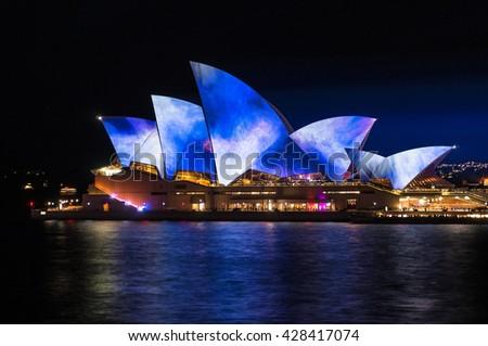 Sydney, Australia - 2016, May 27: Sydney Opera House illumination Lighting the Sails Songlines during annual outdoor lighting festival Vivid Sydney: Festival of Light, Music & Ideas. Long exposure - stock photo