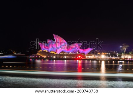 "Sydney, Australia - May 23, 2015: Sydney Opera House projection ""Lighting the Sails"". Part of an annual light festival Vivid Sydney. Long exposure. Circular Quay, Sydney, Australia. - stock photo"