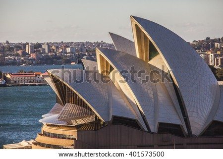Sydney, Australia - May 13, 2015: Sydney Opera House  with early morning sunlight - stock photo