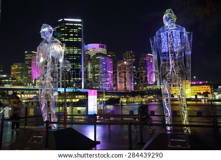 SYDNEY, AUSTRALIA - MAY 27, 2015; Sydney Vivid exhibit, Exposed reveals the interior worlds of three giant humanoid figures, each of which is transparent.  - stock photo