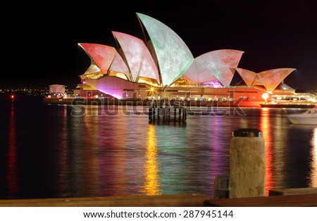 SYDNEY, AUSTRALIA - MAY 27, 2015; The Sydney Opera House during Vivid Sydney annual festival.  Coloured lights and patterns shine on the roof like these watercolours from a long exposure. - stock photo