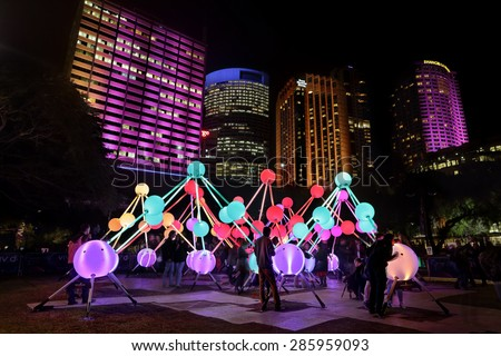 SYDNEY, AUSTRALIA, MAY 27, 2015:  Tourists and public enjoy the Affinity installation at Vivid Sydney, which depict the  human brain and neurons.  When touched, the orbs display sound and light.