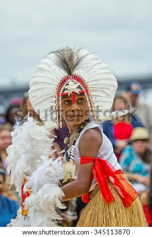 SYDNEY,AUSTRALIA - NOVEMBER 22,2015: A boy from the Torres Strait Islands performs a dance in a competition during the Homeground festival - a major annual celebration of aboriginal culture.