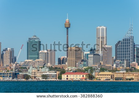 SYDNEY, AUSTRALIA - NOVEMBER 9, 2014: Australian Sydney landmark - city CBD high rises and towers forming megapolis cityscape, Sydney, NSW, Australia. The Garden Island dockyard in the foreground.