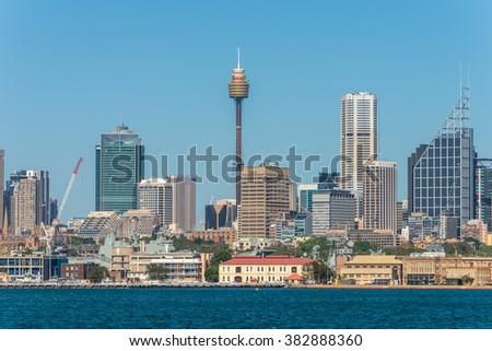 SYDNEY, AUSTRALIA - NOVEMBER 9, 2014: Australian Sydney landmark - city CBD high rises and towers forming megapolis cityscape, Sydney, NSW, Australia. The Garden Island dockyard in the foreground. - stock photo