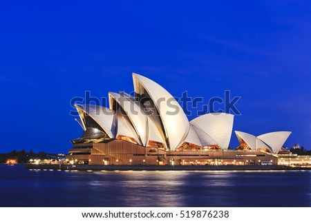 Sydney, Australia - 15 November 2016: Iconic worlds' buildings - Sydney Opera house in full glory at sunset brightly illuminated