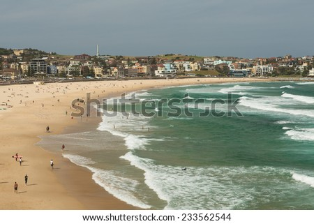 SYDNEY, AUSTRALIA - NOVEMBER 25, 2014: Located in the Eastern suburbs, Bondi beach is the most famous and trendy beach in Sydney where people celebrate the waves both as surfers and swimmers.  - stock photo