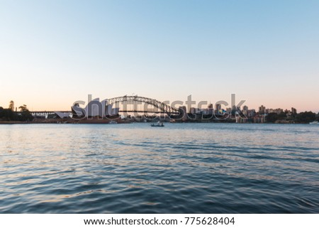 SYDNEY, AUSTRALIA - NOVEMBER 8, 2017: Sydney Opera House and Harbour Bridge at sunset with clear sky.