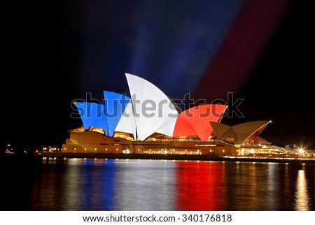 SYDNEY, AUSTRALIA - NOVEMBER 16, 2015;  Sydney Opera House lit up in colours of the French flag... blue, white and red in support of mulitple tragic terrorist events in France - stock photo