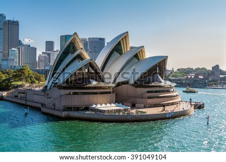 SYDNEY, AUSTRALIA - NOVEMBER 12, 2014: Sydney Opera House view from a cruise ship in Sydney, Australia. Sydney Opera House was designed by Danish architect Jorn Utzon, finally opening in 1973. - stock photo