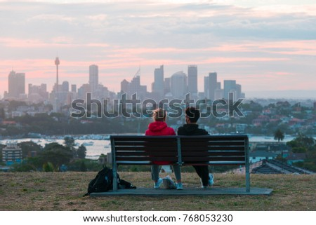 SYDNEY, AUSTRALIA - OCTOBER 24, 2017: People watching sunset with Sydney city on the background.