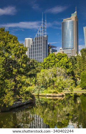 SYDNEY, AUSTRALIA - OCTOBER, 27: Shady park - a place for recreation for people. Sydney's Eastern Skyline taken from the Botanic Gardens October 27, 2015 in Sydney, Australia.