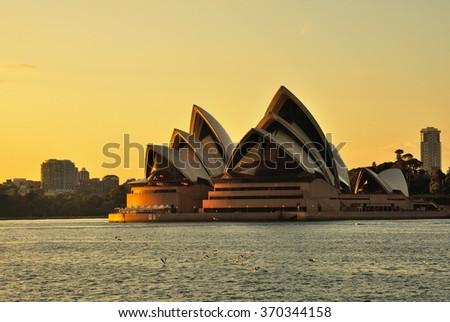 SYDNEY, AUSTRALIA - OCTOBER 20, 2015: Sunrise over The Iconic Sydney Opera. Sydney Opera house is considered as the major landmark of Sydney and tourists attraction. - stock photo