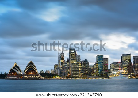 SYDNEY, AUSTRALIA - OCTOBER-3: Sydney Opera House and office building on October-3, 2014 in Sydney, Australia. - stock photo