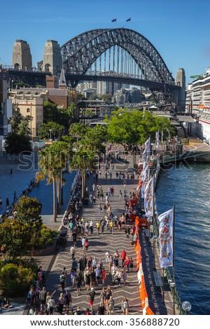 Sydney, Australia on 30th Dec 2015: The Rocks is an urban locality, tourist precinct and historic area of Sydney's city centre next to the overseas passenger terminal under the harbour bridge - stock photo