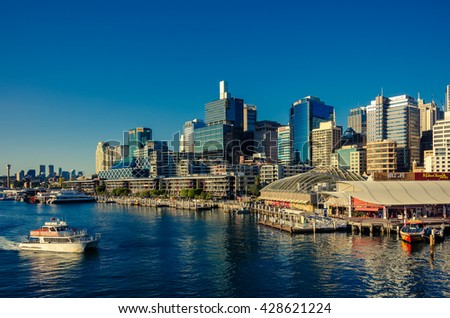 Sydney, Australia - September 14, 2012: Beautiful Darling Harbor skyline with boats at sunset. Darling Harbour is a large recreational and pedestrian precinct in the Sydney CBD