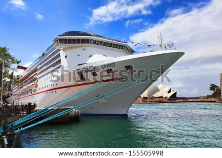 Sydney, Australia - September 15, 2013:  Carnival Spirit, of Carnival Cruise Lines,, at its dock port at Sydney Harbour. Passengers await its departure for a 12 night Pacific Islands Cruise.    - stock photo