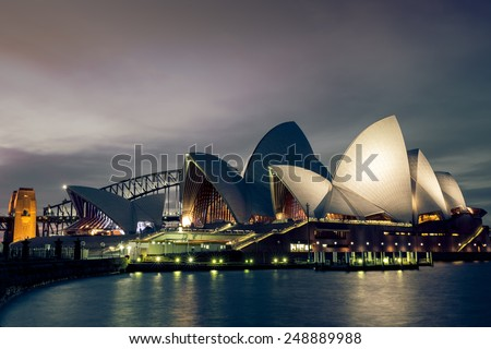 Sydney, Australia - September 20: Night view of the Sydney Opera House with the Harbour Bridge in the background, in Sydney, Australia on September 20, 2014.