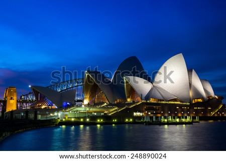 Sydney, Australia - September 20: Night view of the Sydney Opera House with the Harbour Bridge in the background, in Sydney, Australia on September 20, 2014. - stock photo