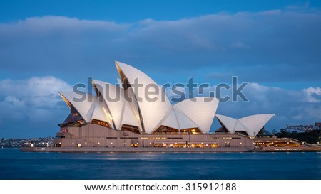 SYDNEY, AUSTRALIA SEPTEMBER 26: Sydney Opera House at dusk with low clouds in the background. Taken on September 26, 2011. - stock photo
