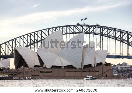 Sydney, Australia - September 20: The Sydney Opera House with the Harbor Bridge in the background, in Sydney, Australia on September 20, 2014. - stock photo