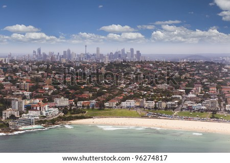 Sydney CBD and suburbs aerial view from Bondi beach and ocean to city centre with skyscrapers from Helicopter