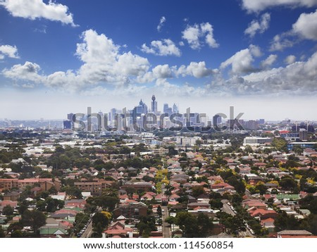 sydney city CBD aerial view from helicopter above surrounding residential suburbs blue cloudy sky - stock photo