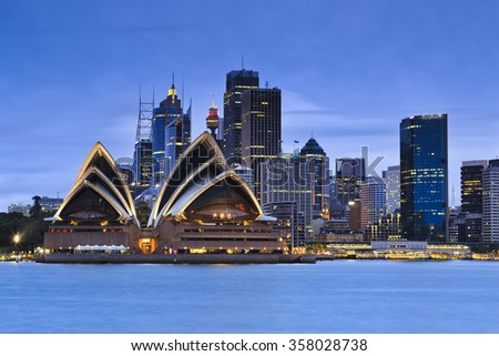 Sydney city CBD landmarks at blue sunset as seen from Kirribilli over harbour