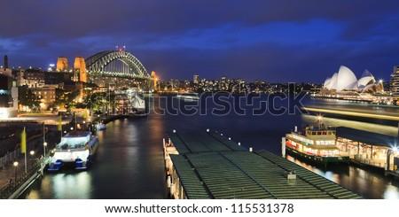 sydney city circular quay sunset lights and illumination blue cloudy dusk - stock photo