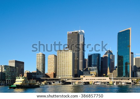 Sydney city skyline shot with circular quay including quay, skyscrapers and few vessels - stock photo