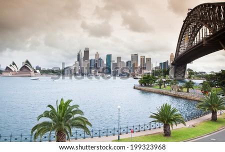 SYDNEY - DEC 12: Landscape of Sydney. The Sydney Harbour Bridge was open to the public in 1932. It is the fifth longest spanning arch-bridge in the world. Dec 12 2011 in Sydney, Australia NSW.  - stock photo