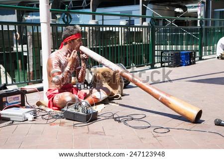 SYDNEY-DECEMBER 20, 2014: Aborigin  performed their music at Sydney harbour in Sydney,Australia on 20 December 2014 . Aborigin is the local people of Australia. - stock photo