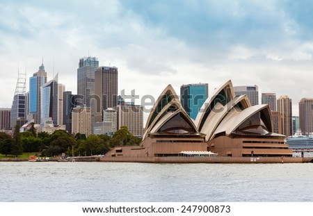 SYDNEY - DECEMBER 21, 2011: Opera House and skylines with city vegetation on background. The Sydney Opera House is a famous arts center. It was designed by Danish architect Jorn Utzon.