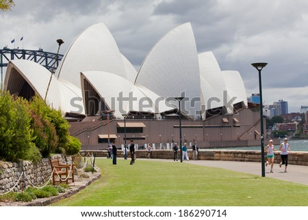 SYDNEY - DECEMBER 15: Royal Botanic Gardens, and the Iconic Sydney Opera House. Is a multi-venue performing arts centre also containing bars. December 15, 2011 in Sydney, Australia.  - stock photo