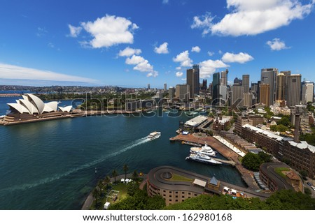 SYDNEY - DECEMBER 29: The Iconic Sydney Opera House is a moulti-venue performing arts centre also containing bars and outdoor restaurants. December 29, 2009 in Sydney, Australia.  - stock photo