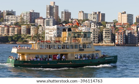 Sydney - February 25, 2016: Beautiful green-yellow passenger Sydney ferry carries passengers to the port of Sydney February 25, 2016, Sydney, Australia