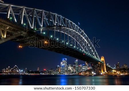 Sydney Harbour Bridge and the Opera House at night - stock photo
