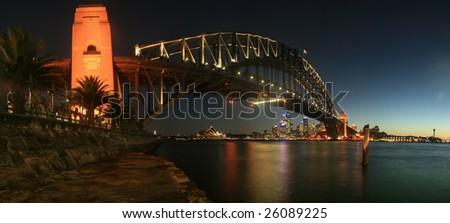 Sydney Harbour (Harbor) Bridge at night panorama - stock photo