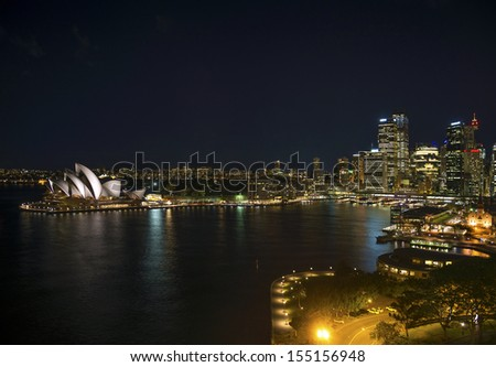 sydney harbour with opera house in australia by night - stock photo