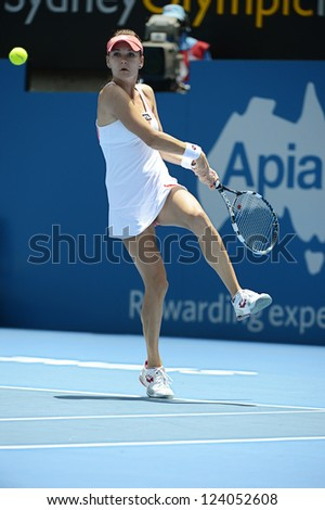 SYDNEY - JAN 9: Agnieszka Radwanska from Poland reaches for a backhand in her quater final match in the APIA Sydney Tennis International. Sydney January 9, 2013. - stock photo