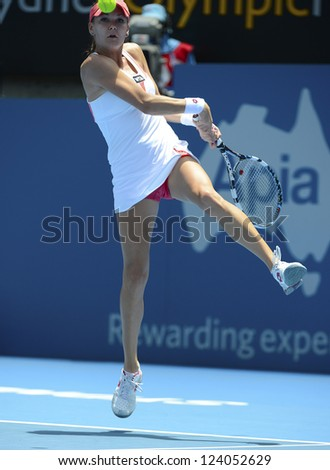 SYDNEY - JAN 9: Agnieszka Radwanska from Poland reaches for a backhand in her quater final match in the APIA Sydney Tennis International. Sydney January 9, 2013.