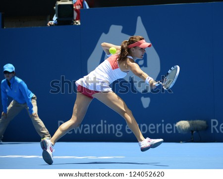 SYDNEY - JAN 9: Agnieszka Radwanska from Poland stretches for a backhand in her quater final match in the APIA Sydney Tennis International. Sydney January 9, 2013. - stock photo