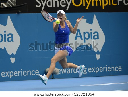 SYDNEY - JAN 8: Caroline Wozniacki from the Denmark hitting a running forehand in her first round match in the APIA Sydney Tennis International. Sydney January 8, 2013.